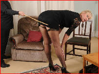 Mature woman caned in short dress and stockings