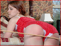 Submissive girl takes her Master's cane on her pert cheeks